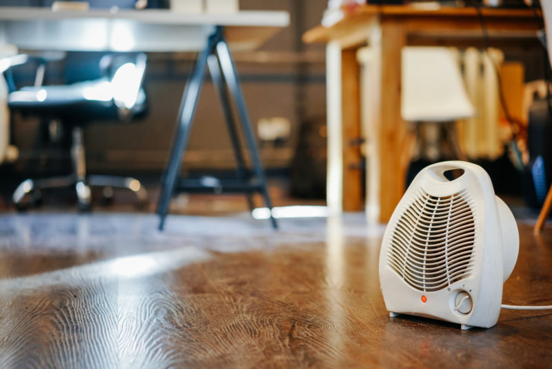 space heater sitting on floor of office