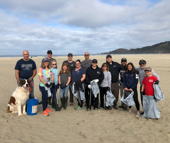 Central Lincoln employees, family and friends cleaning up Agate Beach in Newport for the 2019 SOLVE Beach and Riverside Cleanup