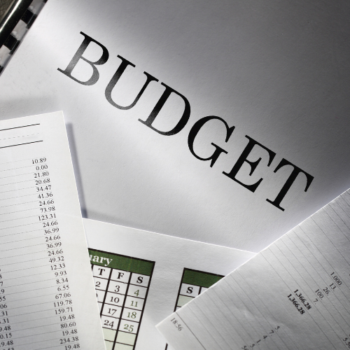 Image of spreadsheets and a booklet with the word budget written on it