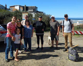 Central Lincoln employees gather at Heceta Beach in Florence for the beach and riverside cleanup