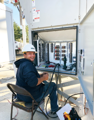 Journeyman Maintenance Wireman, Justin, wiring on a substation panel