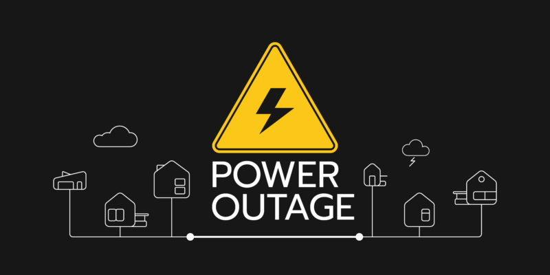 image of an electric symbol and the words power outage