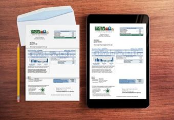 Photo of a paper Central Lincoln electric bill and an electronic version on a tablet showing that they are similar
