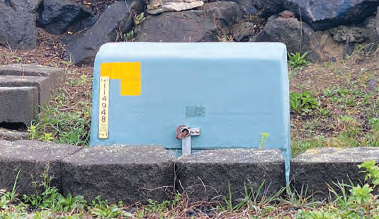 blue switch stand box, or transformer, in someone's yard